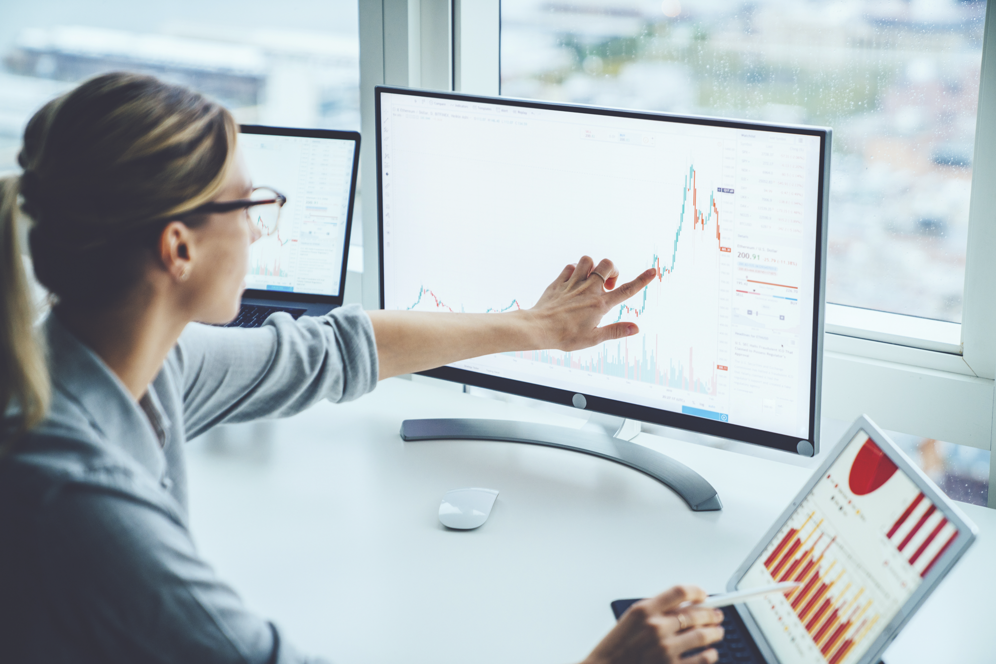 Woman looking at a chart to estimate the value of search engine optimization.
